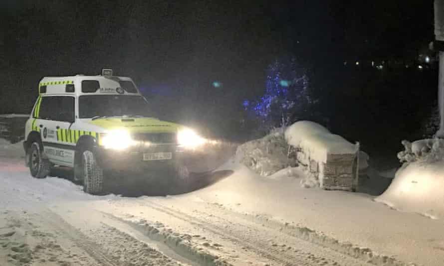 Ambulance in snow, near Burnley