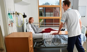 Nursing student Ben Craig, 24, attends to a Kettering patient, Kirsty Williams