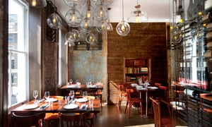 The Ninth restaurant with hanging glass lights and bare brick walls