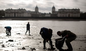 The banks of the River Thames being cleaned at low tide