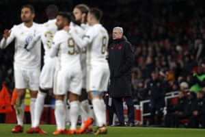 Arsene Wenger looks bemused as Ostersunds' players celebrate.
