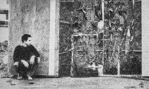 Tony Manzaroli with a slate on asbestos sheet, October 1961.