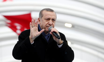 Turkish President Recep Tayyip Erdogan delivers a speech during the opening ceremony of the Eurasia Tunnel.