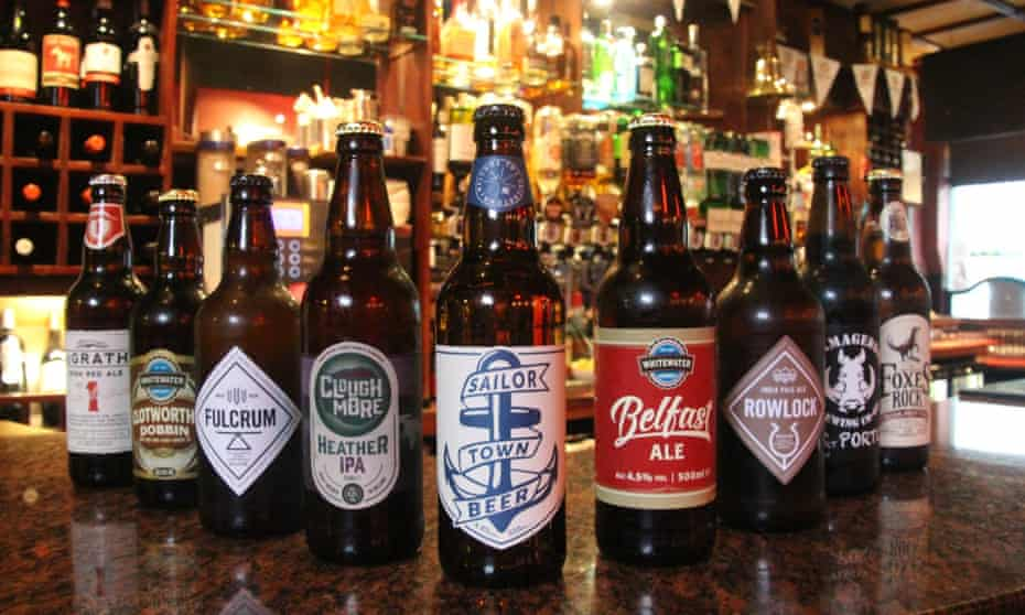Bottled beers lined up on the bar at The John Hewitt pub in Belfast, Northern Ireland.