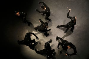 Dancers wearing motion-capture suits are filmed in the studio.