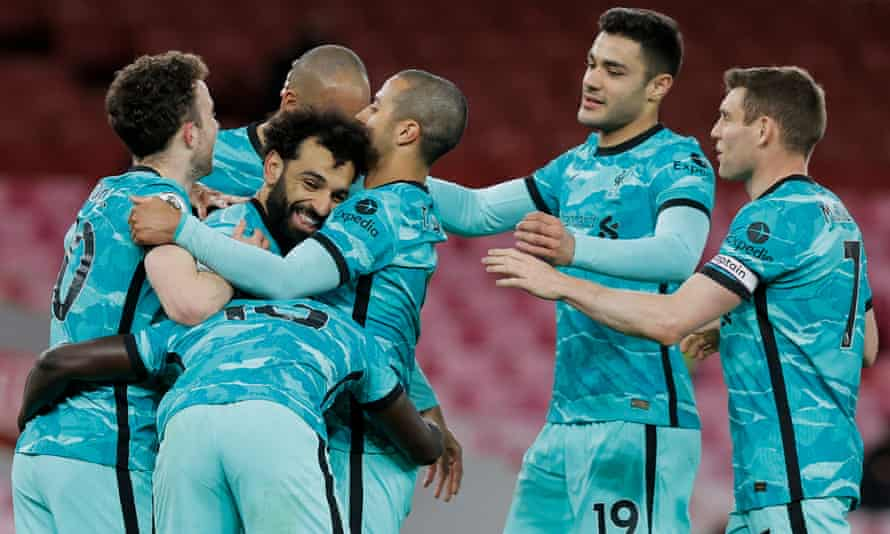 Mohamed Salah is congratulated after scoring Liverpool's second goal