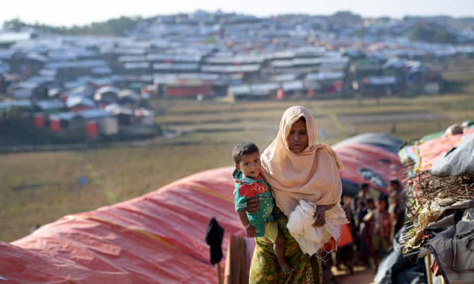 A Rohingya woman and child walk through the Jamtoli refugee camp in Bangladesh. More than 640,000 Rohingya people have fled Myanmar.