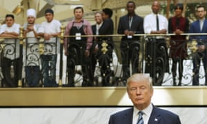 Hotel employees watch the Republican presidential nominee, Donald Trump, following a ribbon cutting ceremony at the new Trump International Hotel in Washington DC on Wednesday.