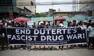 Protesters at a funeral march for the 17-year-old student Kian Delos Santos.