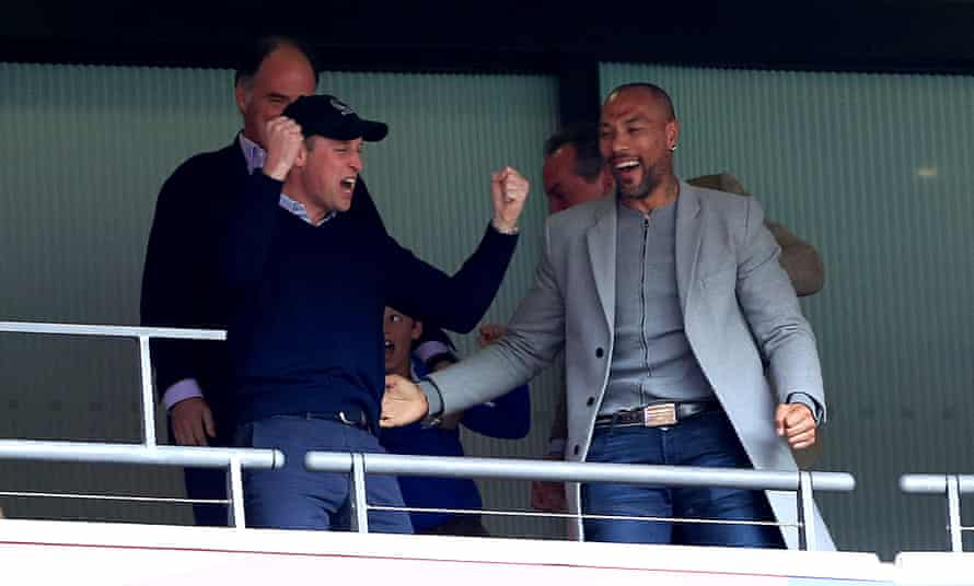 The Duke of Cambridge celebrates in the stands with former player John Carew.