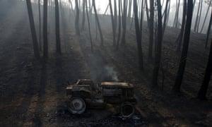A burned-out tractor near Castanheira de Pera.