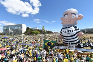 <strong>Brasilia </strong>Demonstrators hold up an inflatable representing former President Lula dressed as a convict in front of the congress