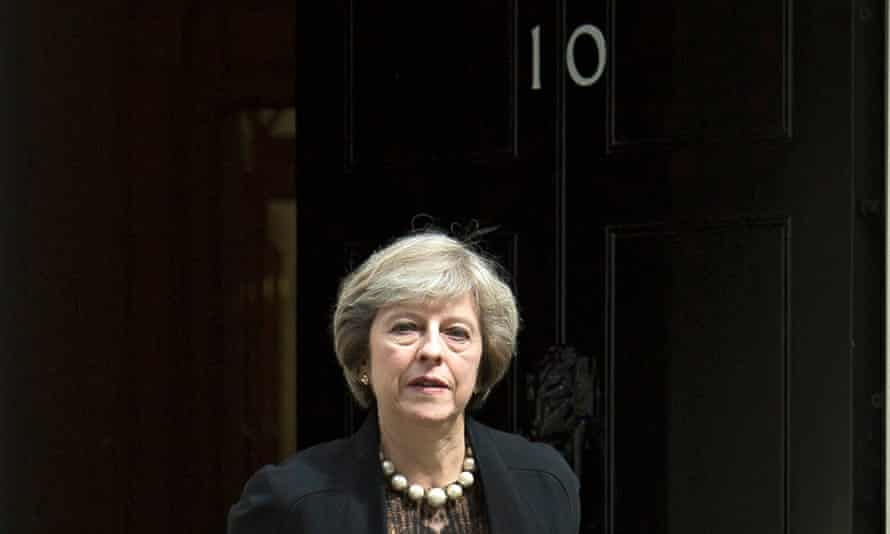 Theresa May leaving No 10 Downing Street after a cabinet meeting.