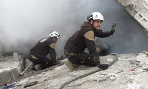 Civil defence team members tackle a fire in a building in Idlib following a regime airstrike this month.
