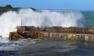 Mullion Cove in Cornwall was battered with large waves.