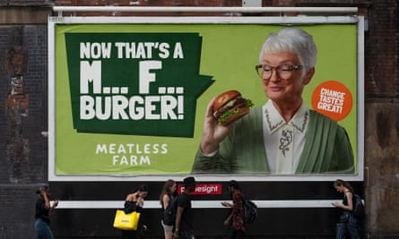 Advert of a woman holding a burger, strapline says: