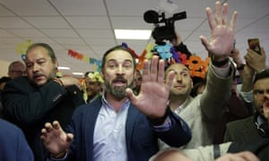 Santiago Abascal, centre, leader of far-right party Vox, gestures after casting his ballot at a polling station for Spain's general election in Madrid.
