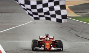 Sebastian Vettel takes the chequered flag at the Bahrain Grand Prix.