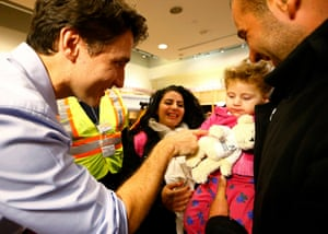 Syrian refugees are greeted by Canada's Prime Minister Justin Trudeau on their arrival from Beirut at the Toronto Pearson International Airport.
