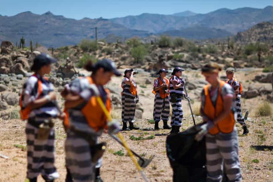 An all-female chain gang works in 40C heat in Arizona.