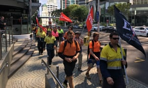 About 200 workers marched through Brisbane
