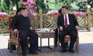 Kim Jong-un, left, meet the Chinese president, Xi Jinping, in Dalian.