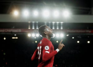 Divock Origi celebrates after scoring his second goal against Everton, in a frantic derby that saw six first-half goals.