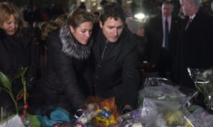 Canadian prime minister Justin Trudeau and his wife Sophie Grégoire Trudeau place flowers at a memorial at the Québec City mosque.