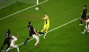 Hungarian goalkeeper Peter Gulacsi fails to connect with a cross.