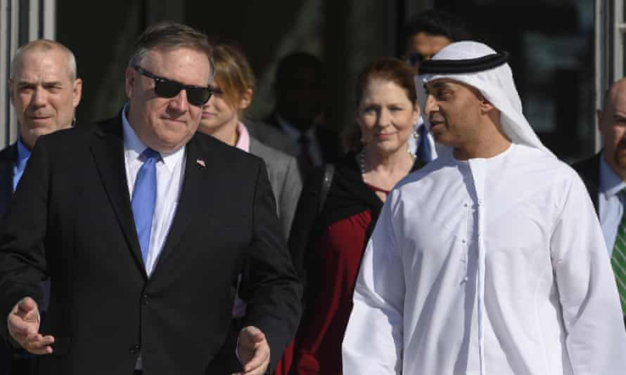 The US secretary of state, Mike Pompeo, speaks with the Emirati ambassador to the US, Yousef al-Otaiba, in Abu Dhabi.