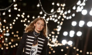 Model Gigi Hadid presents a creation from Tommy Hilfiger's new collection at New York Fashion Week.