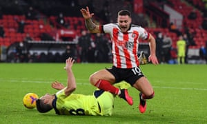 Newcastle United's Argentinian defender Federico Fernandez (L) fouls Sheffield United's English striker Billy Sharp to concede a penalty.