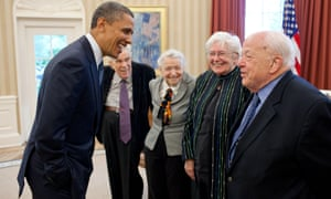 Burton Richter, right, and his wife, Laurose, being greeted by Barack Obama in the White House in 2010.