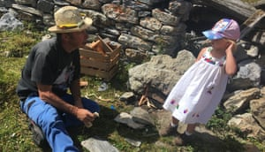 Farmer Marius Pannatier teaches the writer's daughter how to make fire.