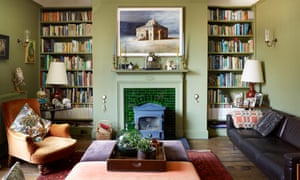 Greener living: the sitting room with Robin Day sofas and Ed Kluz painting.