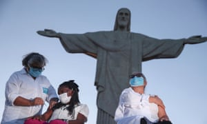 Rio de Janeiro began its vaccination campaign with a televised ceremony – and jabs – beneath the famous Christ the Redeemer statue overlooking the city.