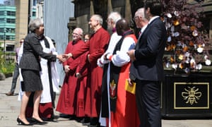 Theresa May greeting members of the clergy as she arrives at The Manchester Arena National Service of Commemoration at Manchester Cathedral earlier today.