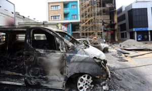 Charred vehicles in Tripoli, following exchanges of rocket and artillery fire in the capital