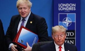 Boris Johnson behind Donald Trump at the Nato summit.
