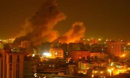 An explosion rocks a residential neighborhood of Baghdad during the Iraq invasion.
