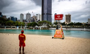A lifeguard watches seagulls instead of people at the deserted South Bank beach on Saturday.