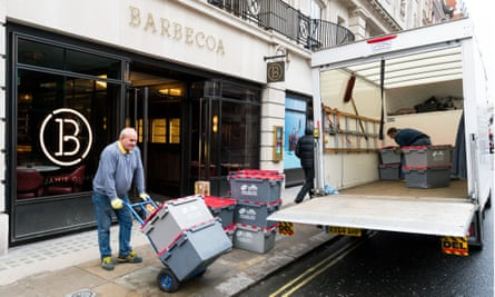 Removal men take away stock from Jamie Oliver's Barbecoa restaurant in Piccadilly, London.
