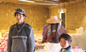 Aureliano Mauricio Valero and family work collecting salt at Colchani, having been displaced from Lake Poopó 150km to the north.