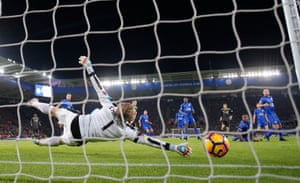 Marcos Alonso, with the help of a deflection off Wes Morgan, scores the second Chelsea goal.