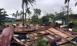 A family digs through the remains of their home in the town of Ba, after it was destroyed by cyclone Winston, the only category five storm system to ever hit Fiji.
