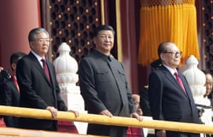 The Chinese president, Xi Jinping, centre, with former presidents Jiang Zemin, right, and Hu Jintao, left, attend the celebration to commemorate the 70th anniversary of the founding of communist China.