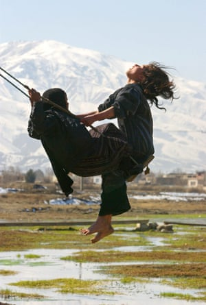 Kabul, 2003. Friends play on a homemade swing during the festival of Eid.