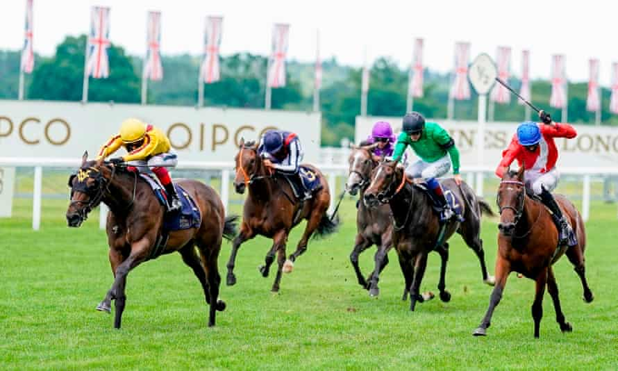 Frankie Dettori riding Campanelle (yellow) wins the Queen Mary Stakes at Royal Ascot last year.