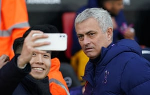 Tottenham manager José Mourinho grimaces as he poses with a fan for a selfie prior to kick off against Southampton.