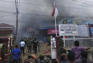 Smoke billows from Kabanjahe prison, North Sumatra, during a riot on 12 February.